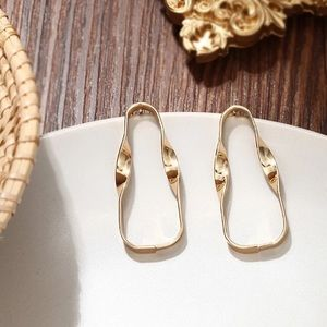 Hallow gold tone earrings